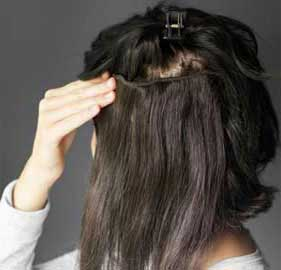 applying hair weave