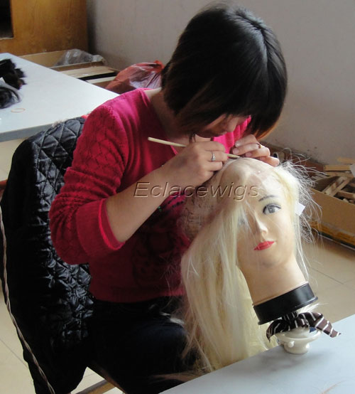 worker tie hair on wig lace